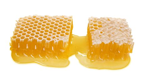 Large piece of bee honeycomb with liquid honey isolated on white background, natural healthy food, close-up