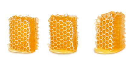 Three pieces of bee honeycomb with liquid honey isolated on white background, natural apiculture Reklamní fotografie