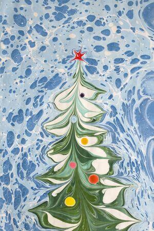 Christmas tree drawn on paper. Ebru Technique Stock Photo