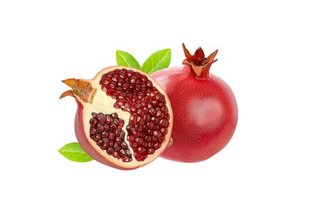 Pomegranate fruit isolated on white background. Pomegranate half with fresh juicy grains and green leaves, close up Stok Fotoğraf