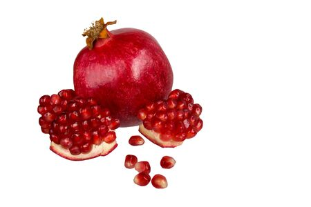 Pomegranate grains and a ripe pomegranate isolated on white background Stok Fotoğraf