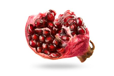 Pomegranate grains isolated on white background with shadow