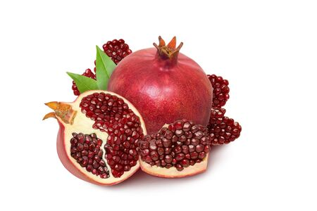 Pomegranate fruit isolated on white background with slices, half pomegranate and green leaves