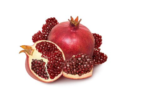 Isolated garnet. Ripe pomegranate fruit with grain slices isolated on white background as package design element