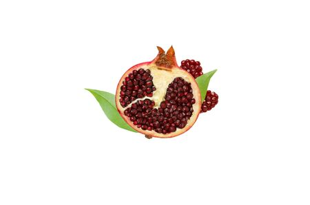 Half a pomegranate with red seeds and green leaves isolated on white background