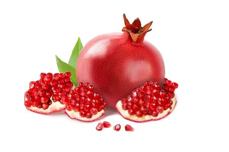 Ripe pomegranate with leaves and grains isolated on a white background