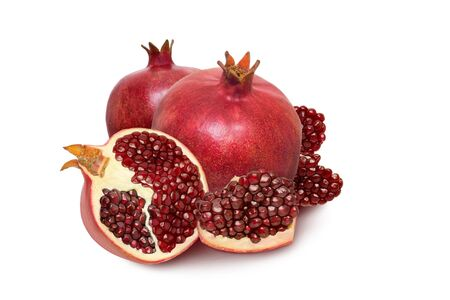 Isolated pomegranate fruit. One ripe red garnet isolated on white background.