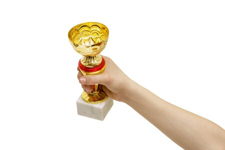 Hand with winning Golden Cup isolated on white background. The concept of victory