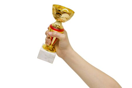 Cup award for winning competitions in hand isolated on white background