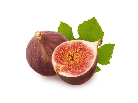 Isolated figs. Ripe juicy raw figs fruit, cut half with pulp and seeds and green fresh leaf isolated on white background with shadow, close-up