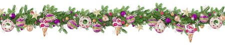 Extra wide Christmas border with fir branches, toys, baubles, balls and snowflakes sprinkled with snow isolated on white. Panoramic format.