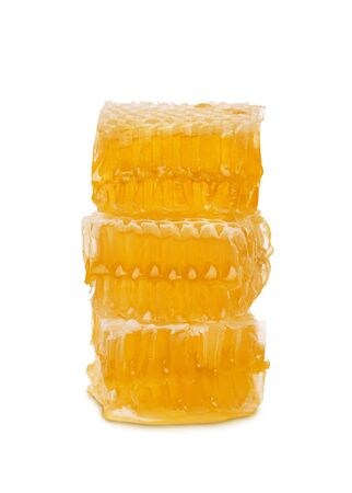 Pieces of honeycomb with honey and beeswax stand vertically isolated on white background