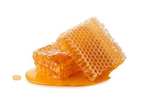 Honeycomb honey and liquid honey isolated on white background