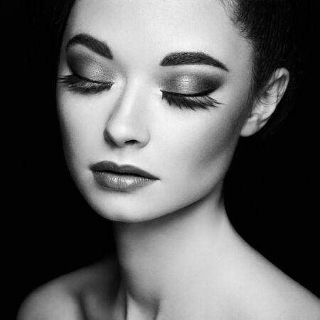 Beautiful woman face. Perfect makeup. Beauty fashion. Eyelashes. Cosmetic Eyeshadow. Black and white photo.