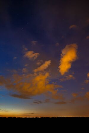 researches: Clouds at sunset in the sky. Stock Photo