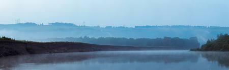 multiple images: Mist over the smooth surface of the river. The fog before sunrise. Panoramic view of the multiple images. Stock Photo