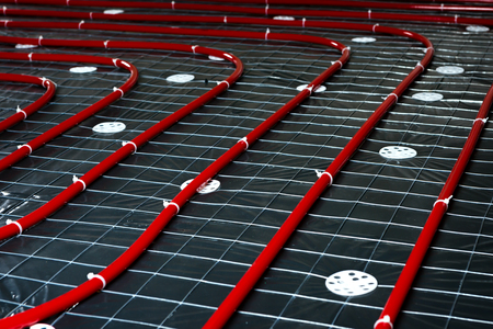 Floor heating pipe. Installation of engineering systems in a building. Stock Photo