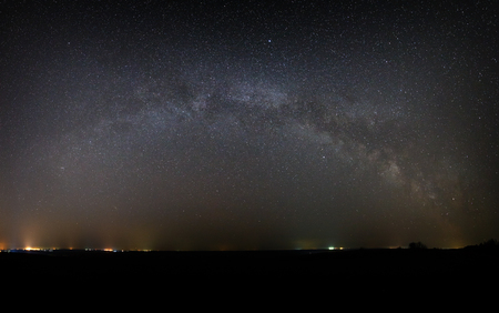 starry night: Panoramic view of the Milky Way Galaxy in the night sky with bright stars. Astrophotography of outer space.