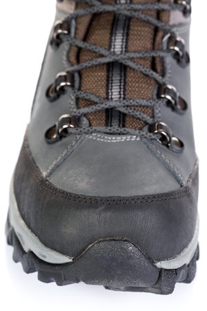 Tourist boots for mountain hikes with reinforced soles and membrane material. Stock Photo