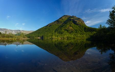 Mountain lake with clear water. Kola Peninsula , Khibiny . Russia.