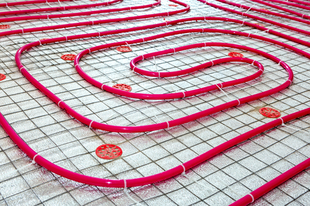 Floor heating pipe. Installation of engineering systems in a building. Stock fotó