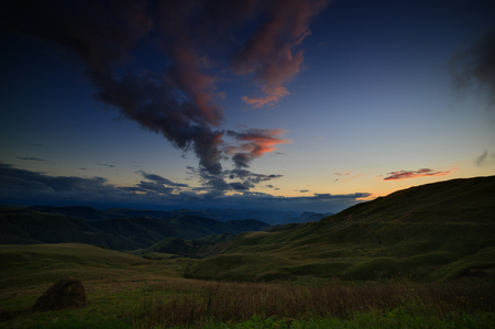 The sky at sunset over the hills in the foothills of the North Caucasus in Russia.