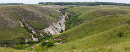 Panoramic view of the destruction of the fertile soil layer. The ravine is formed by rainwater. Stockfoto