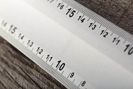Measuring instrument on a wooden background. Tool for repair and construction.