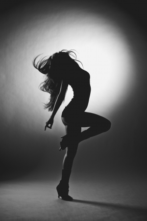 Erotic silhouette of a beautiful young woman photo