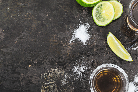 alcoholic drink: Tequila shots with lime slice, top view
