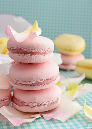 Pink macaroons,macarons with petals on light background,