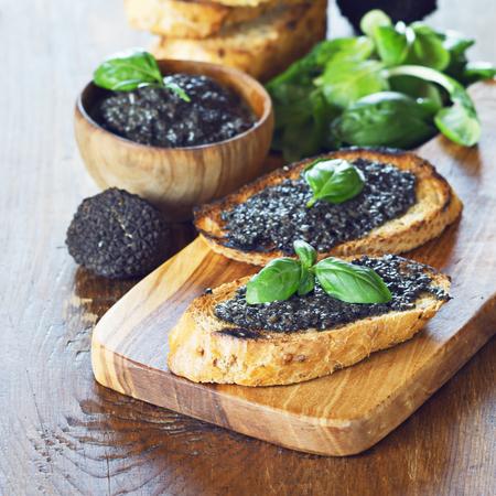Bruschetta with black truffle ,salsa tartufata.