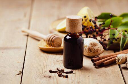 Elderberry syrup with honey, ginger, cinnamon,cloves. Homemade remedy for Immune boosting for flu season, colds.