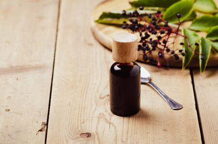 Elderberry syrup. Homemade remedy for Immune boosting for flu season, colds.