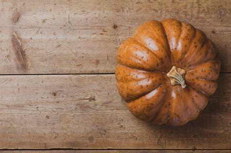 Fall pumpkin on old wooden table. Top view. Copyspace. Stok Fotoğraf