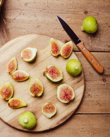 Ripe figs fruit on a wooden board. Stok Fotoğraf