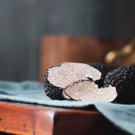 Black truffles  mushrooms on rustic wooden table with free text space Stok Fotoğraf