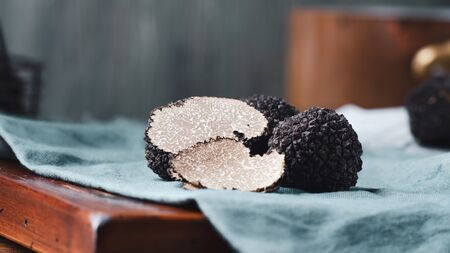 Black truffles  mushrooms on rustic wooden table Stok Fotoğraf