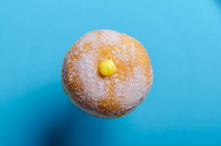 Doughnuts with creamy  filling. Copy space. Blue backgroung