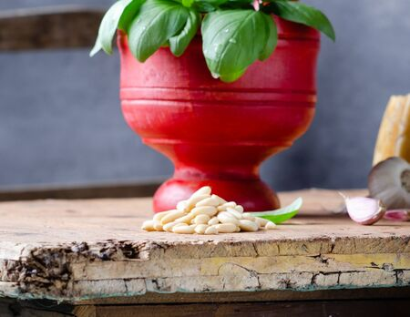 Ingredients  for pesto alla genovese over rustic table.