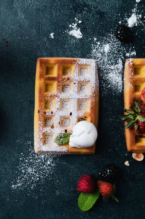 Belgian waffles with  summer fresh berries and honey Banco de Imagens - 130163709