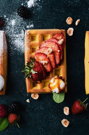 Belgian waffles with  summer fresh berries and honey Banco de Imagens - 130163710
