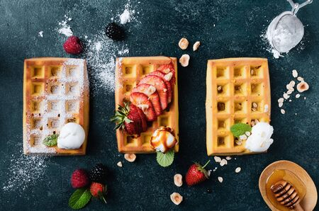 Belgian waffles with  summer fresh berries and honey Banco de Imagens - 130163707