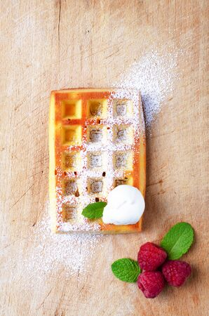 Belgian waffles with  summer fresh berries and honey on wooden board.Top view. Banco de Imagens - 130163713