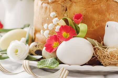 Italian Easter  cake with flowers eggs, dove on white plate. Selective focus, free text space. Banco de Imagens - 130163730