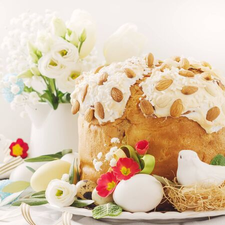 Italian Easter  cake with flowers eggs, dove on white plate. Selective focus, free text space. Banco de Imagens - 130163729