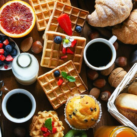 Health and colorful breakfast on wooden Фото со стока