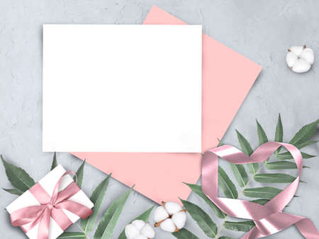 Mock up feminine concept with empty paper blank, gift and ribbons heart on gray background. Elegant still life flatlay for Mothers day, Womans day or wedding invitation.