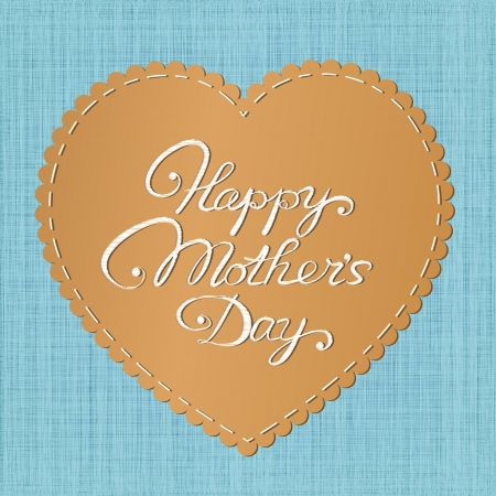 sewn:  Happy mother s day  card  Stylized leather heart-shaped label with embroidered letters against jeans background