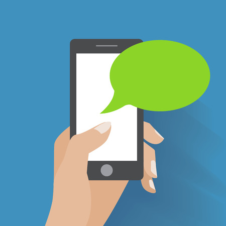 Hand holing smartphone with blank speech bubble for text.